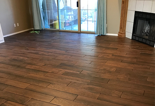 Wood look tile installation by Quality Carpet & Tile
